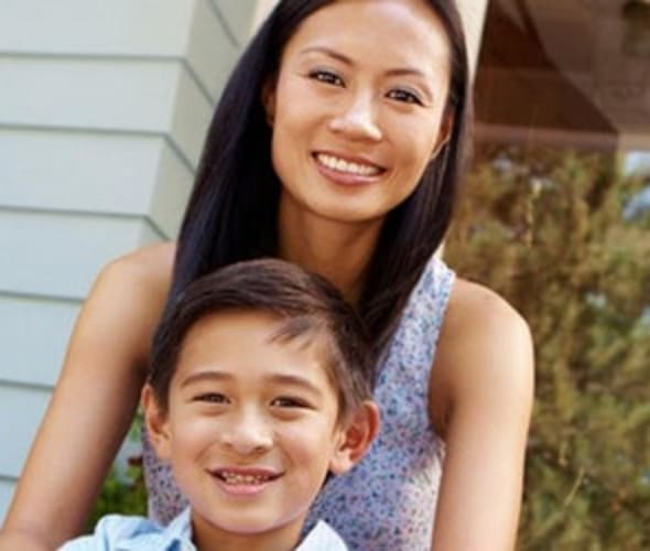 a mom sits on the stoop of her rental home insured by AAA insurance