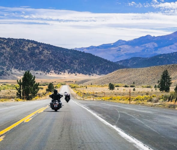 Motocycle covered by AAA Insurance driving the open road