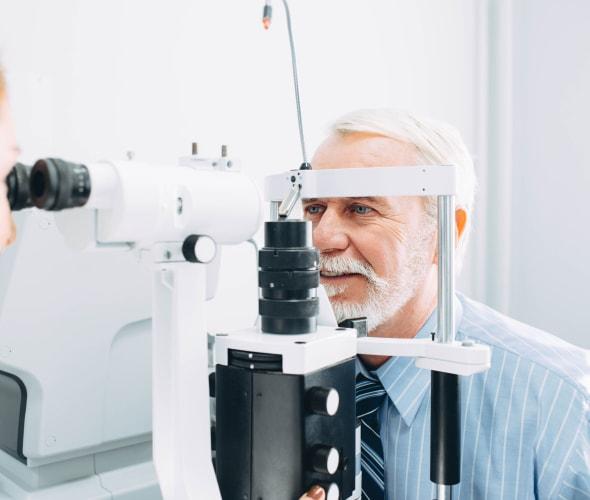 Senior man having an eye exam.