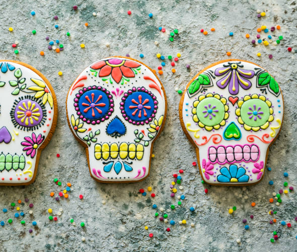 Cookies decorated like sugar skulls for Day of the Dead.
