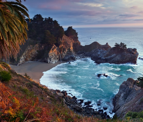 McWay Falls in Big Sur, California in fall at sunset.